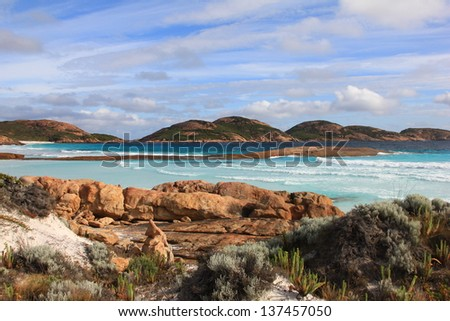 Blue water and sky framed with rocks in Fraser Island, Australia - stock photo