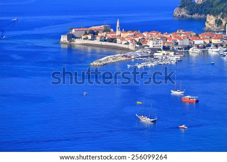 Blue water around Venetian old town surrounded by small boats on the Adriatic sea, Budva, Montenegro - stock photo