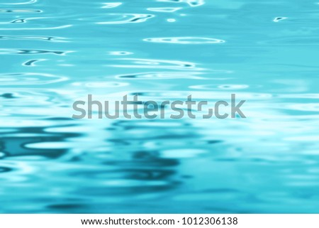Blue water background - swimming pool surface