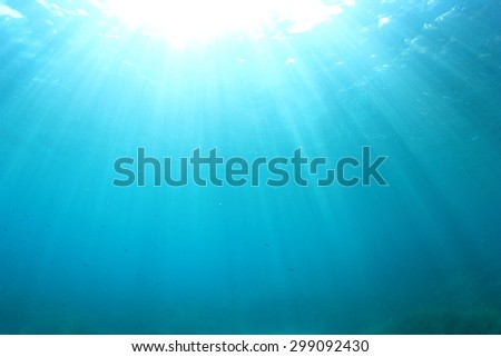 Blue water background underwater in ocean - stock photo