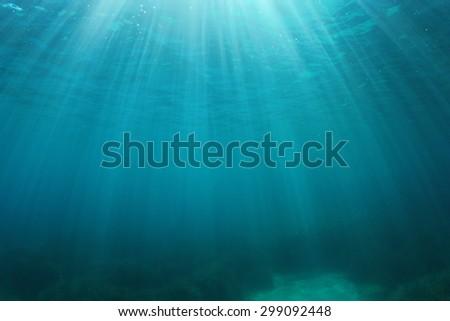 Blue water background underwater in ocean - stock photo