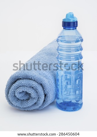 Blue Water Bottle and Towel for sweat wipe - stock photo
