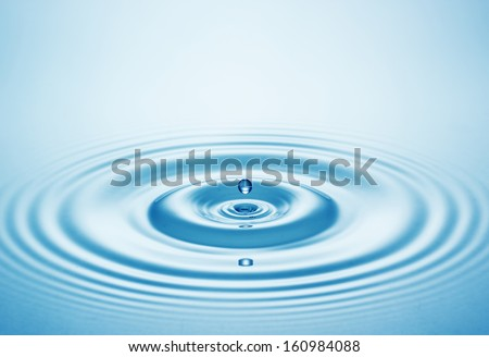 Blue water drop falling down - stock photo