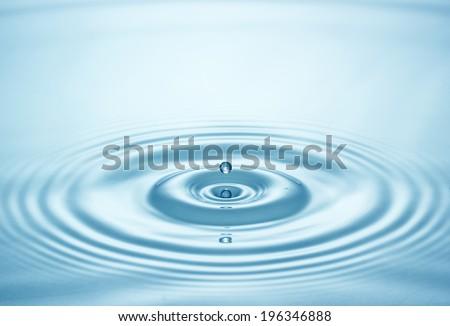 Blue water drop falling down - stock photo