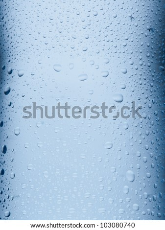 Blue water drops background clos up