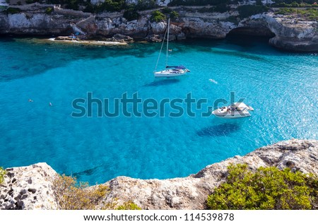 Blue water in the bay with luxury yachts - stock photo