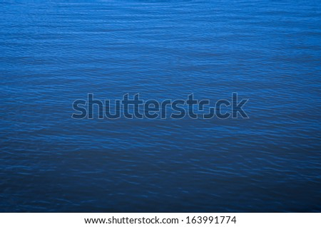 Blue water in the river in cloudy days - stock photo