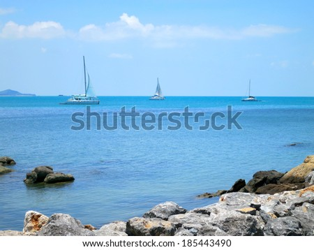 Blue water lagoon with rocks and boats at Koh Samui, Thailand - stock photo