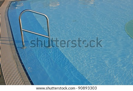 blue water of the swimming pool for swimming competitions - stock photo