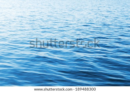 Blue water photo background with soft waves - stock photo