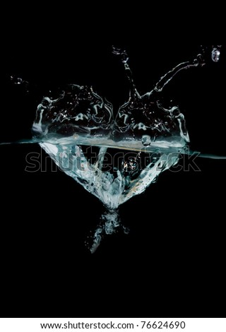 blue water shaped as a heart on black background - stock photo