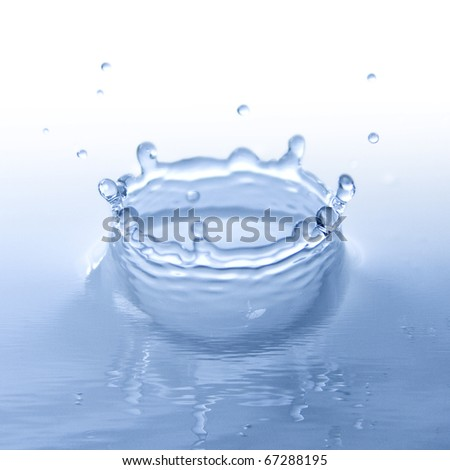 blue water splash with wave effect - stock photo