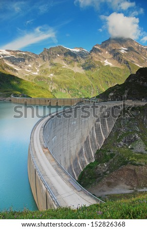 blue water tank with a concrete dam - stock photo