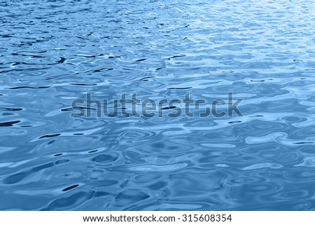 Blue water wave closeup - stock photo