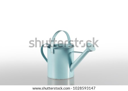 Blue watering can isolated on white background