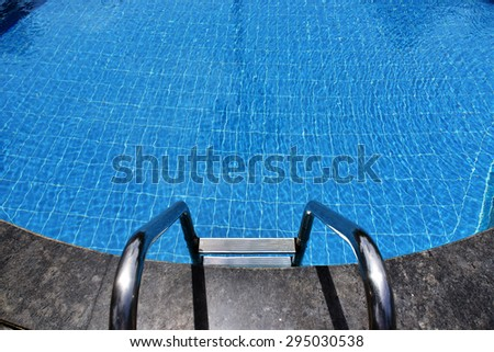 Blue waters of a swimming pool. - stock photo
