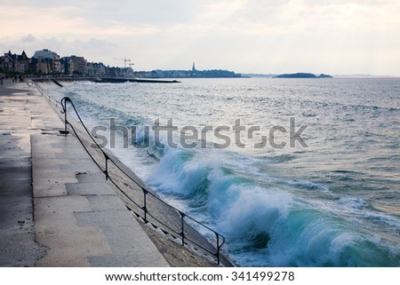 Blue wave at Saint-Malo, view from Rochebonne - stock photo