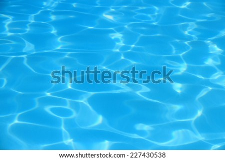 Blue waves in swimming pool as background, top view - stock photo