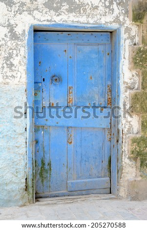 Blue weathered door in Marrakech, Morocco
