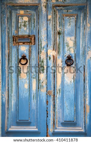 Blue weathered door with door knob and letter box - stock photo