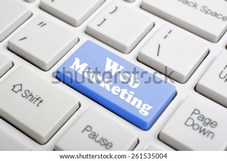 Blue web marketing key on keyboard - stock photo