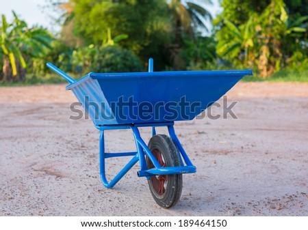 Blue Wheelbarrow - stock photo