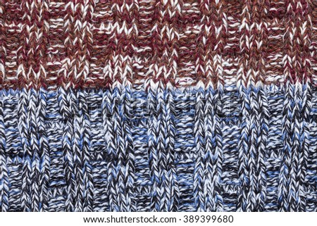 Blue white black brown red mixed knitted fabric made of heathered yarn textured background - stock photo