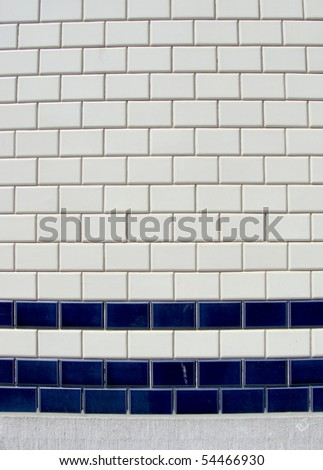 blue white tile pattern on a wall - stock photo