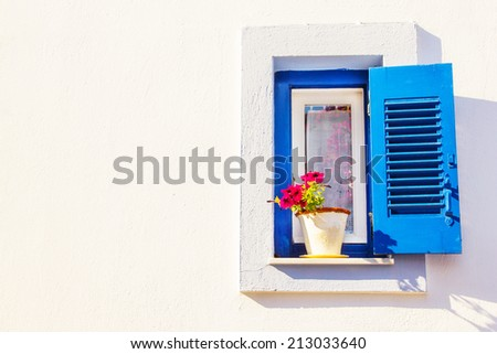 Blue window, part of Skiathos Old Town generic architecture - stock photo