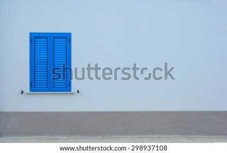 Blue window. Window with blue shutters on a gray wall. Background image for advertising. There is room for text. Space for ad text. - stock photo