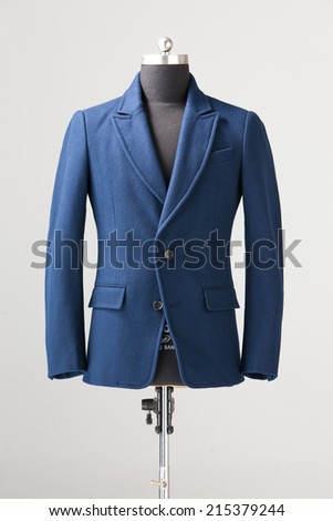 blue winter suit isolated on gray background - stock photo