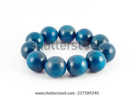 blue wooden beads bracelet isolated on white - stock photo