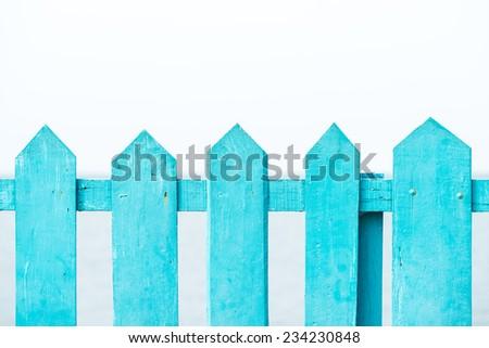 Blue wooden fence on white background. - stock photo