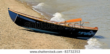 Blue Wooden Rowboat Beached on Sandy Shoreline