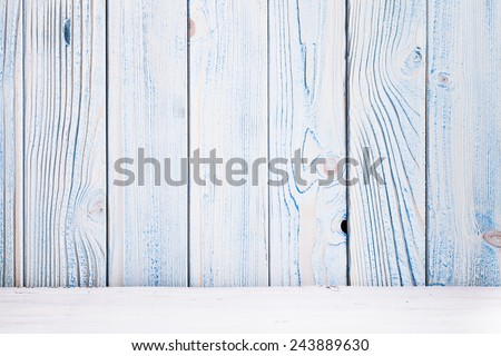 Blue wooden wall, painted in shabby chic style and white floor - stock photo