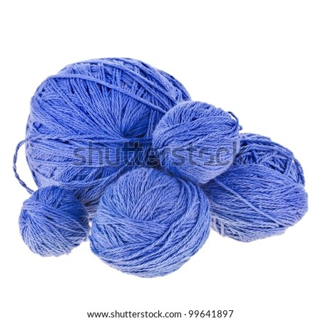 Blue woollen thread for knitting on a white background