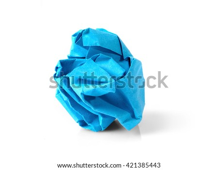 Blue wrinkled paper ball isolated on white background, symbol of recycling and wasting our resources.