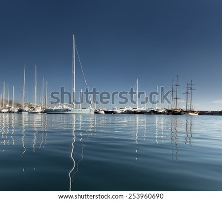 blue yacht on the bay with clear blue sky, day time - stock photo