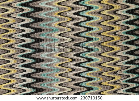 Blue, yellow and grey waves vertical lines pattern fabric as background. - stock photo
