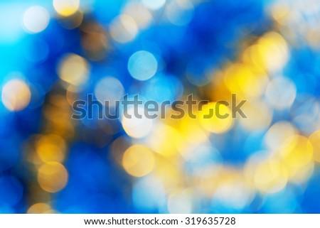 Blue Yellow White bokeh. Christmas background texture - stock photo