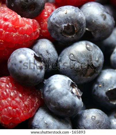 Blueberries and Raspberries - stock photo