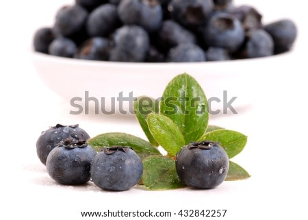 Blueberries. Blueberries isolated on white background. Fresh blueberries.  Blueberries in bowl.  Blueberries with leaves. Blueberries fruits.  Blueberries on white.  Healthy blueberries.