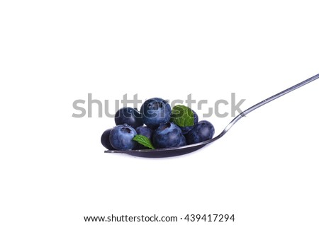 blueberries in a spoon isolated on white