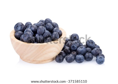 blueberries in wood cup white background.