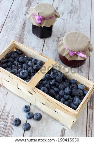 blueberries in wooden basket - stock photo