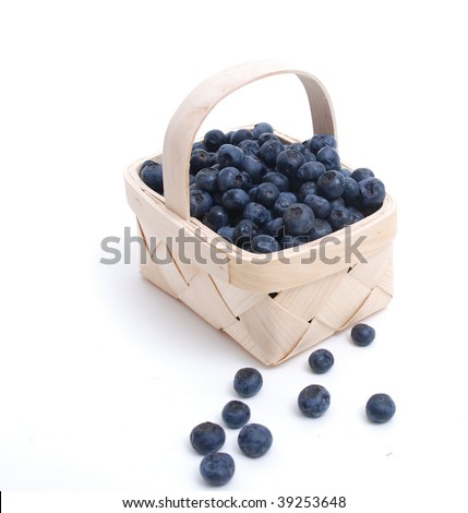 blueberries in wooden basket isolated on white background