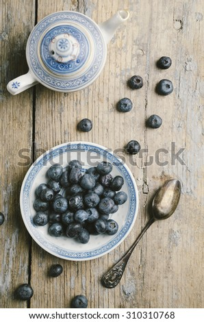Blueberries on rustic wooden table - stock photo