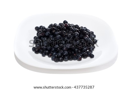 blueberries on white plate isolated on a white background