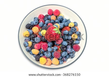 Blueberries,Raspberries and Strawberries in Bowl, Clipping path - stock photo
