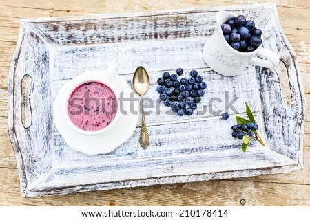 Blueberries with yogurt - stock photo